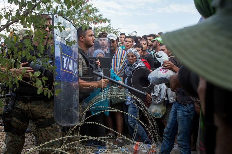 Migrants Crossing Buffer Zone Of The Greek-Fyrom Border